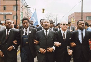 Martin Luther King leading march from Selma to Montgomery to protest lack of voting rights for African Americans. Beside King is John Lewis, Reverend Jesse Douglas, James Forman and Ralph Abernathy. March 1965. (Photo Credit: Steve Schapiro/Corbis) Source: http://www.history.com/photos/martin-luther-king-jr/photo8